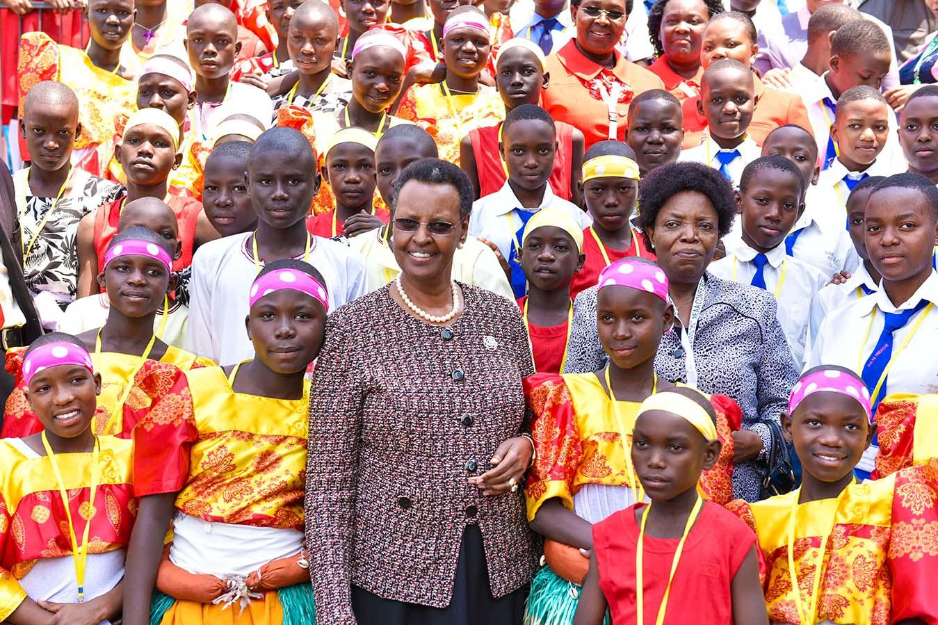 First Lady poses with children as she opened AEAA - Munyonyo